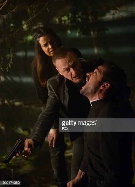 Zuleikha Robinson Ben Daniels and Alfonso Herrera in the 'Unworthy' season finale episode of THE EXORCIST airing Friday Dec 15 on FOX