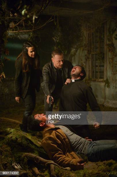 Zuleikha Robinson Ben Daniels John Cho and Alfonso Herrera in the season finale 'Unworthy' episode of THE EXORCIST airing Friday Dec 15 on FOX