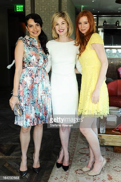 Zuleikha Robinson Rosamund Pike and Odessa Rae attend the LK Bennett Tea Luncheon at Soho House on March 14 2013 in West Hollywood California