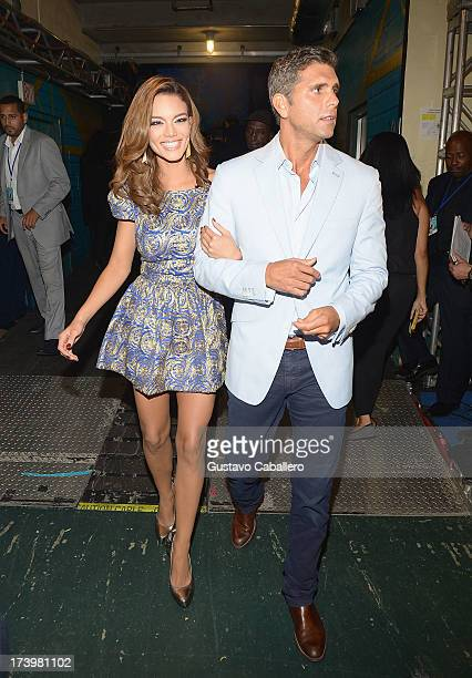 Zuleyka Rivera and Christian Meier are seen backstage during the Premios Juventud 2013 at Bank United Center on July 18 2013 in Miami Florida