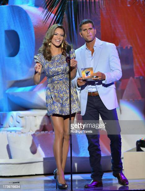 Zuleyka Rivera and Christian Meier speak onstage during the Premios Juventud 2013 at Bank United Center on July 18 2013 in Miami Florida