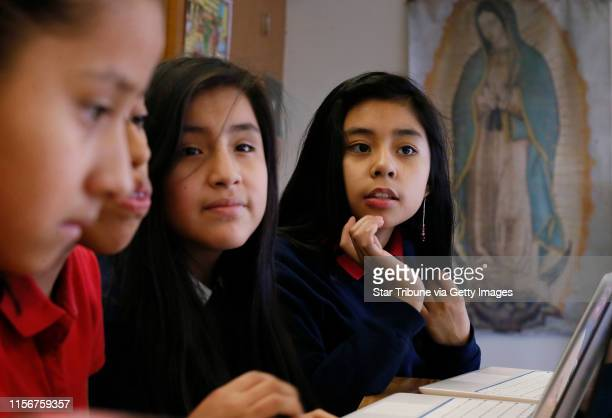 Zuleyma VargasLanda left Katie MendezCruz Joanna Torres and Karen GilCastillo all sixth graders attended class Thursday at Risen Christ School...