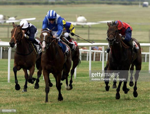 Zulfaa ridden by Richard Hills wins ahead of Burgundy ridden by Paul Doe Aegean Dream ridden by Richard Hughes during the io Group Rated Stakes at...