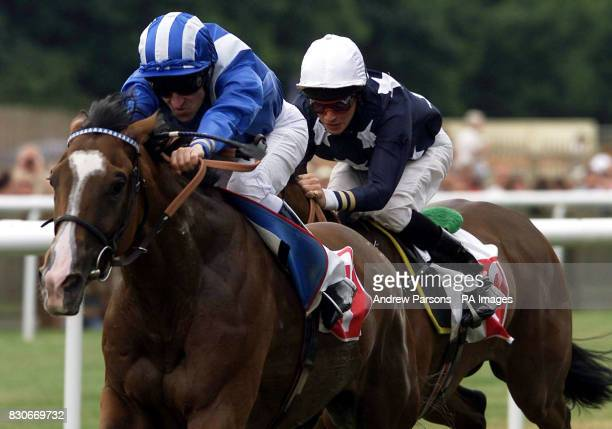 Zulfaa ridden by Richard Hills wins ahead of third place Aegean Dream ridden by Richard Hughes during the io Group Rated Stakes at Newmarket...