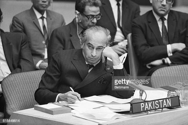 Zulfikar Ali Bhutto Foreign Minister of the reorganized Pakistani government of President Agha Mohammed Khan listens to Indian Foreign Minister...