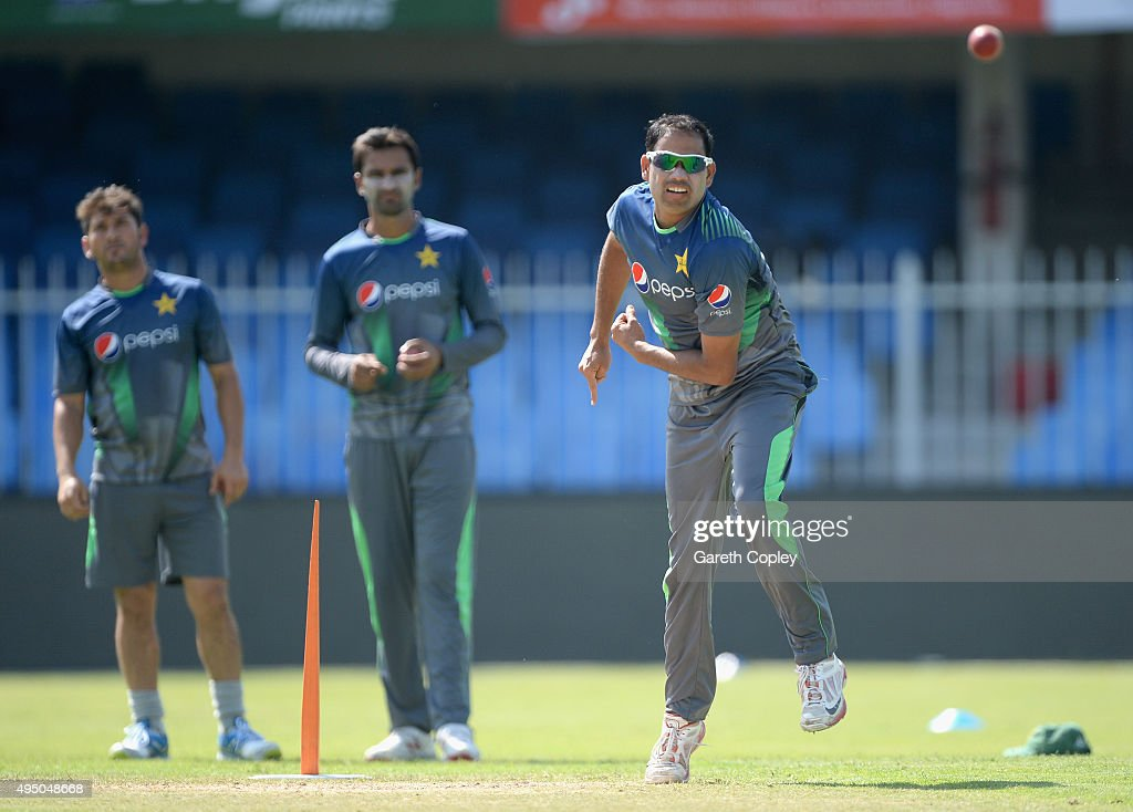 Zulfiqar Babar of Pakistan bowls watched by Yasir Shah and Bilal Asif during a nets session at Sharjah Cricket Stadium on October 31, 2015 in Sharjah, United Arab Emirates.
