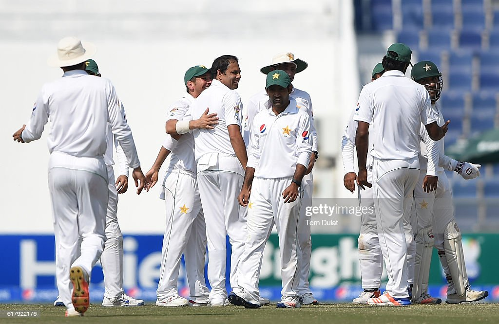 Zulfiqar Babar of Pakistan celebrates with the team taking the wicket of Shai Hope of West Indies during Day Five of the Second Test between Pakistan and West Indies at Zayed Cricket Stadium on October 25, 2016 in Abu Dhabi, United Arab Emirates.