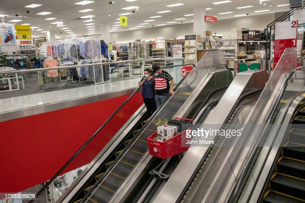 Zully and Marvin shop at Target on May 20 2020 in Stamford Connecticut The Guatemalan immigrants fell sick to Covid19 in March and are now adjusting...