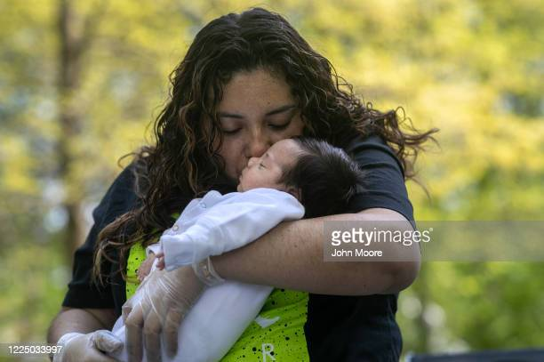 Zully holds her infant son Neysel six weeks after meeting him for the first time on May 14 2020 in Stamford Connecticut Zully and her family now all...