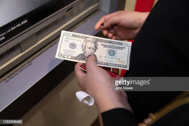 Zully makes her first ATM withdrawal on June 25 2020 in Stamford Connecticut She her husband Marvin and their son Junior survived Coronavirus in...