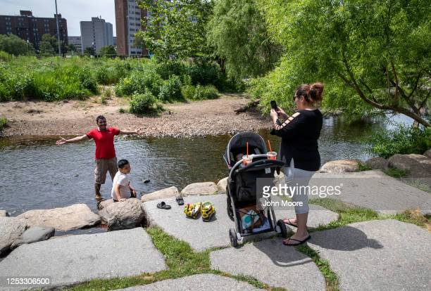 Zully photographs her husband Marvin and son Junior at a park on June 25 2020 in Stamford Connecticut Marvin Zully and Junior survived Coronavirus in...