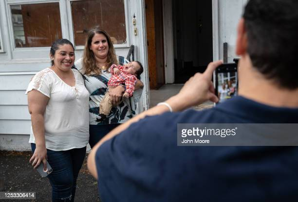 Zully poses for photos with elementary school teacher Luciana Lira and Zully's son Neysel 10 weeks at a dinner celebrating Neysel's three month...
