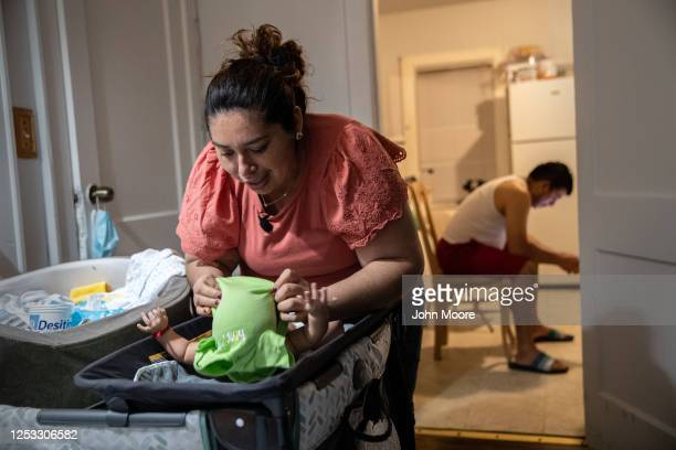 Zully prepares her son Neysel 10 weeks for bed on June 17 2020 in Stamford Connecticut On April 1 Zully then almost 8 months pregnant was...