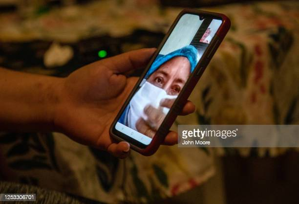 Zully speaks on a video call with her Covidsick mother Aurora on June 17 2020 in Stamford Connecticut Aurora who lives in Guatemala became ill with...