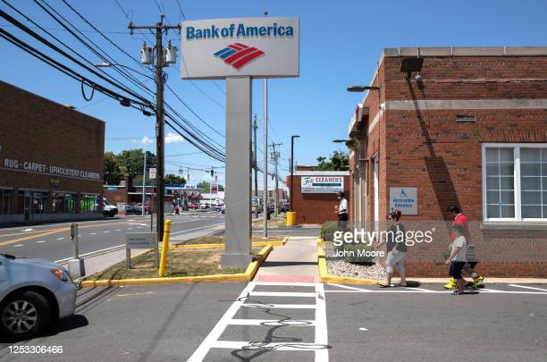 Zully walks to the bank for her first withdrawal with her husband Marvin and sons Junior and Neysel 10 weeks on June 25 2020 in Stamford Connecticut...