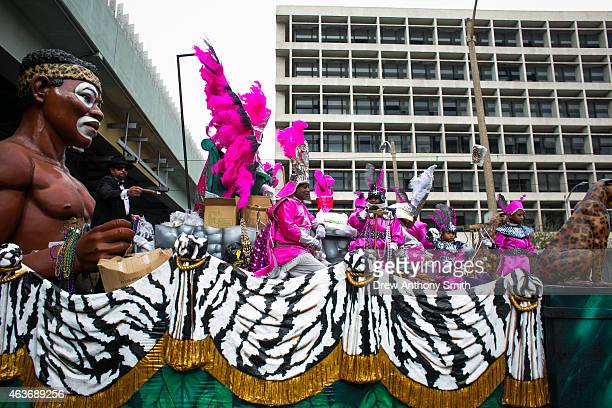 Zulu Krewe members ride parade floats in the streets during Mardi Gras February 17 2015 in New Orleans Louisiana Mardi Gras or Fat Tuesday is a...