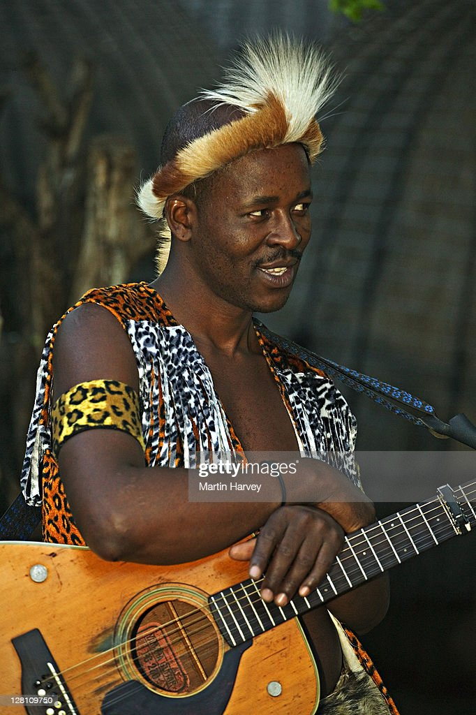 Zulu Man In Traditional Dress With Guitar Lesedi Cultural