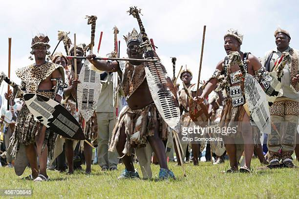 Zulu men perform a traditional dance on the hills above former South African President Nelson Mandela's home village during his state funeral...