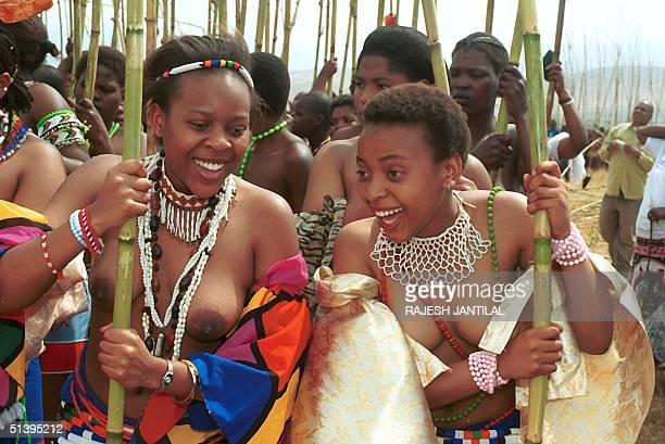 Zulu Royal princesses and Khonza share a light moment during the annual traditional reed dance held at the residence of King Goodwill Zwelithini in...