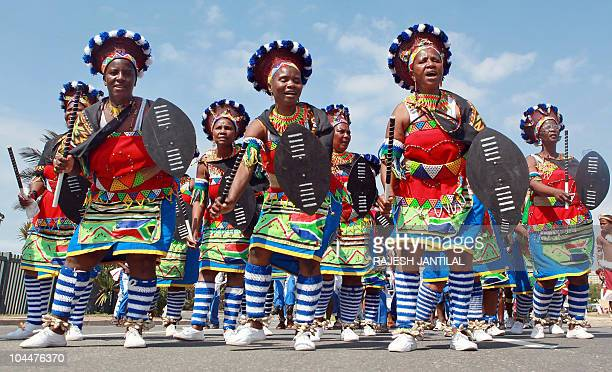 Zulu traditional clad dancers and singers march to celebrate South African Heritage Day in Durban on September 24 2010 AFP PHOTO/RAJESH JANTILAL