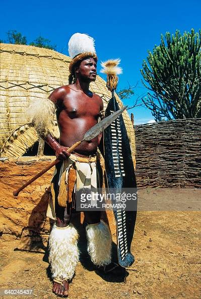 Zulu warrior holding a spear and shield, KwaZulu-Natal ...