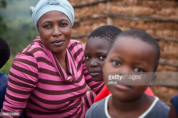 zulu woman and children in rural south africa - zulu women stock pictures, royalty-free photos & images