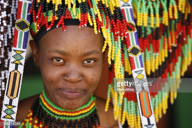 zulu woman and her souvenirs - south african culture stock photos and pictures