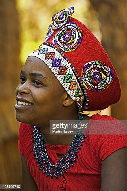 zulu woman in traditional red headdress of a married woman. lesedi cultural village near johannesburg, south africa. - zulu women stock pictures, royalty-free photos & images