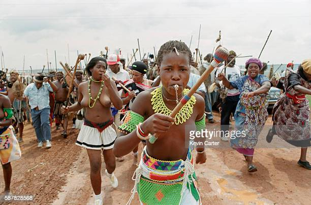 Zulu woman leads a Zulu Impi toward Orlando Stadium to hear Buthelezi speak at an Inkatha Freedom Party rally