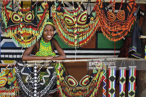 zulu woman with souvenirs - south africa stock pictures, royalty-free photos & images