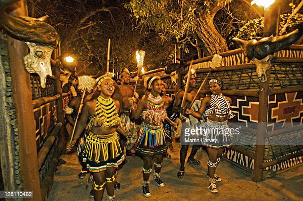 zulu women dancing in costume of a young zulu maiden. the entire outfit is made of beads. this costume is worn during festivals or dancing ceremonies. lesedi cultural village near johannesburg south africa - zulu women stock pictures, royalty-free photos & images