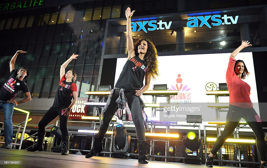 Zumba celebrity instructor Gina Grant and professional wrestler Eve Torres (R) attend One Billion Rising-Rise with V-Day and Zumba Fitness, One Billion Rising, a Global Day of Action to End Violence against Women and celebrate V-Day's 15th Anniversary at LA Live on February 14, 2013 in Los Angeles, California.