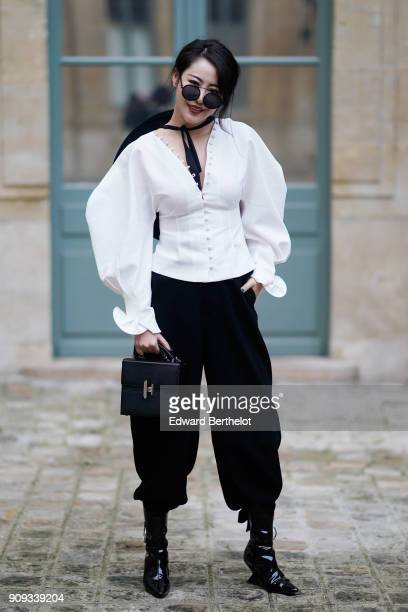 Zuo An Xiao arrives at the Ulyana Sergeenko Presentation as part of Paris Fashion Week Haute Couture Spring Summer 2018 show as part of Paris Fashion...