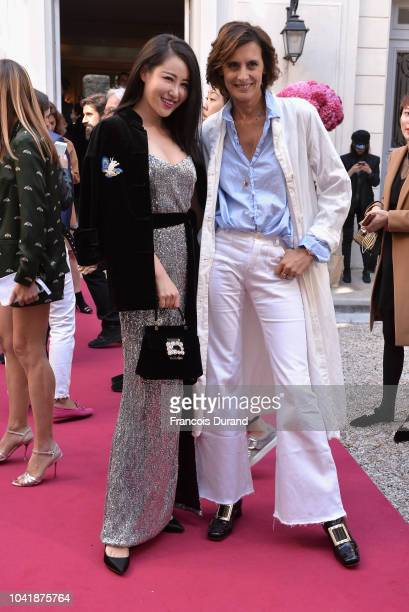 Zuo Anxiao and Ines de la Fressange attend the Roger Vivier Presentation Spring/Summer 2019 during Paris Fashion Week on September 27 2018 in Paris...