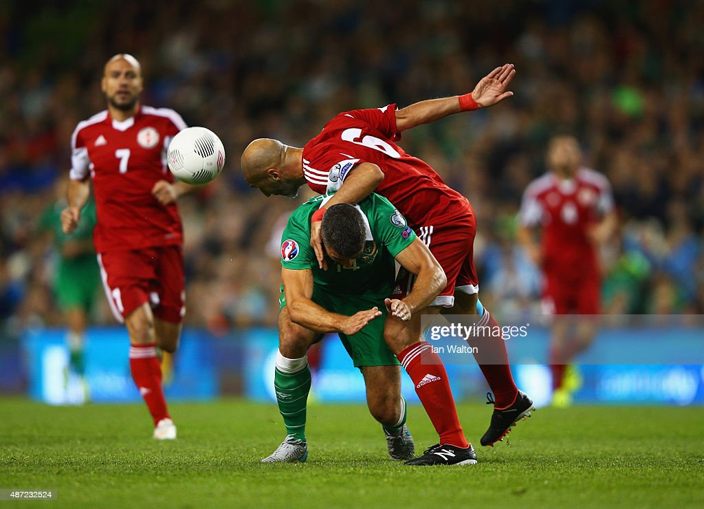 Zurab Khizanishvili of Georgia challenges Jonathan Walters of the Republic of Ireland during the UEFA EURO 2016 Group D qualifying match between Republic of Ireland and Georgia at Aviva Stadium on September 7, 2015 in Dublin, Ireland.