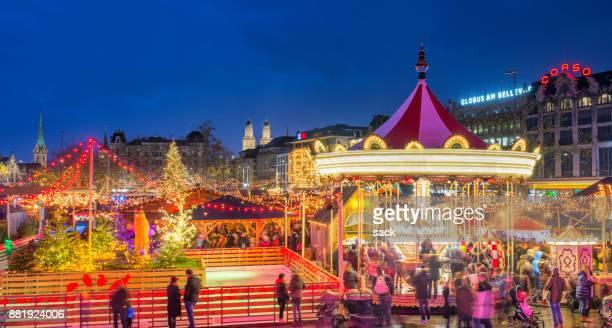 zurich christmas market at bellevue and sechseläutenplatz - zurich stock pictures, royalty-free photos & images