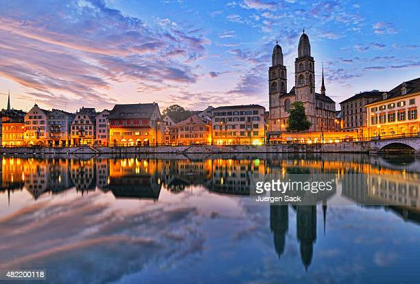 zurich - limmatquai and grossmünster at sunrise - zurich stock pictures, royalty-free photos & images