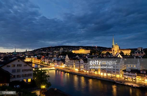 Zurich Niederdorf at night with golden city lights