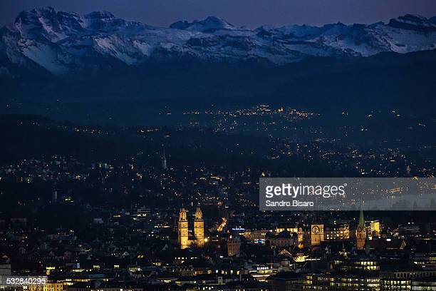 Zurich Old Town with Mountains Skyline in Winter