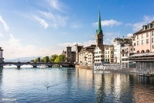 zurich old town with the limmat river in switzerland - チューリッヒ ストックフォトと画像