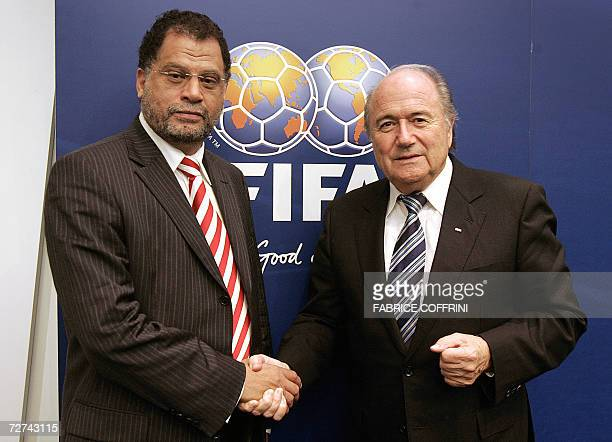 President Sepp Blatter poses with CEO of the Local Organising Committee for the FIFA 2010 World Cup, Danny Jordaan, after a press conference closing...