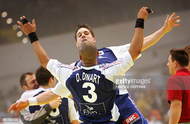 France's Guillaume Gille celebrates with Didier Dinart their victory over Spain at the end of their final match of the European handball...
