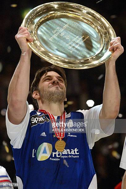 French handball team member Bertrand Gille lifts the trophy of the 2006 European handball championships at Zurich sports hall 05 February 2006 after...