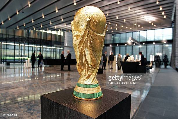 Picture taken 06 December 2006 shows a replica of the FIFA World Cup trophy at the entrance hall of the International football federation...