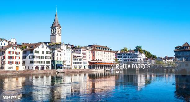 Zurich Switzerland View of the City Center on the Limmat River with the Saint Peter Bell Tower in the Background