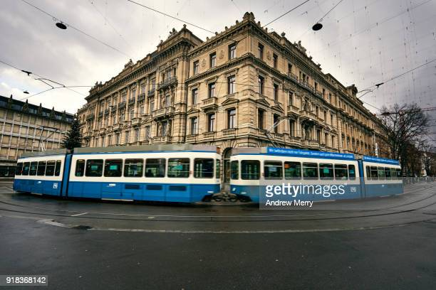 zurich tram drives past credit suisse headquarters, paradeplatz, bahnhofstrasse, zürich - credit suisse stock pictures, royalty-free photos & images