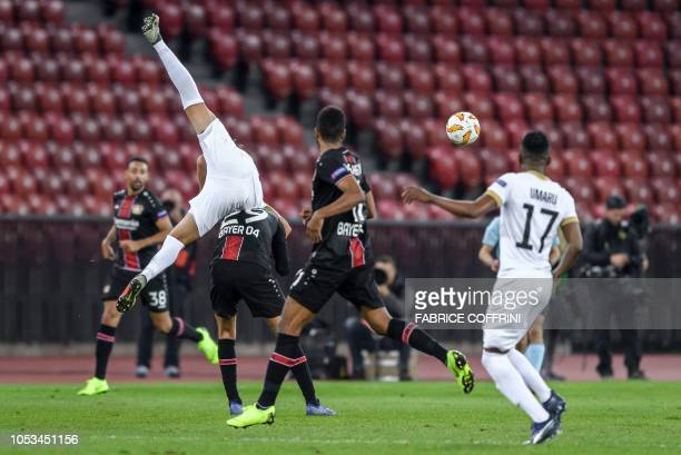 FC Zurich's Danish defender Andreas Maxso falls onto Bayer Leverkusen's German midfielder Kai Havertz during the UEFA Europa League group A football...