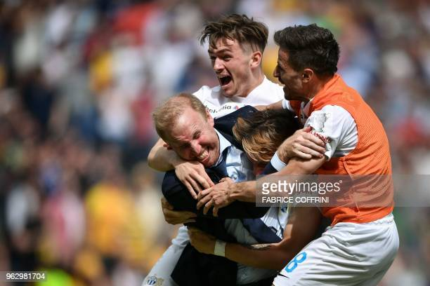 FC Zurich's Swiss head coach Ludovic Magnin celebrates with his players the victory of his team at the end of the Swiss Football Cup final match FC...