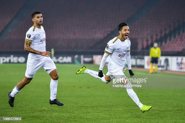 FC Zurich's Swiss midfielder Salim Khelifi celebrates after scoring his team's first goal next to Icelandic midfielder Victor Palsson during the UEFA...