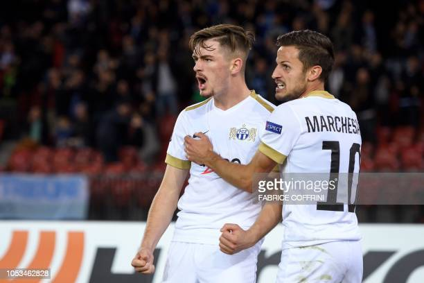 FC Zurich's Swiss midfielder Toni Domgjoni celebrates scoring his team's second goal with teammate Swiss midfielder Antonio Marchesano during the...